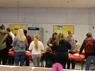 Parents and students work their way through the lunch line