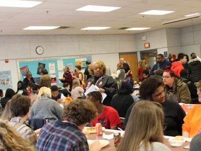 The Quander community enjoying good food and conversation.